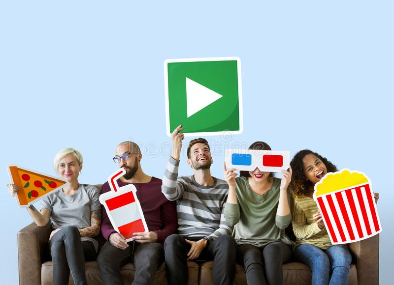 Group of diverse friends holding movie emoticons stock photo