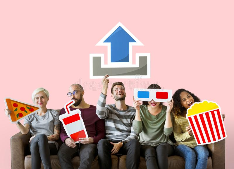 Group of diverse friends and movie upload concept royalty free stock photography