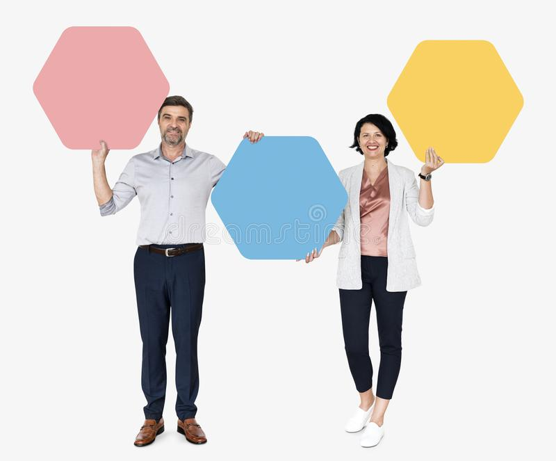 Diverse people showing hexagon shaped boards stock photos