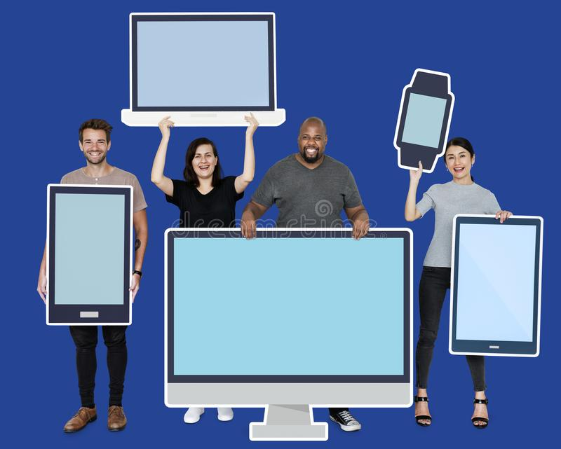 Diverse people with various mockup of digital devices royalty free stock photos