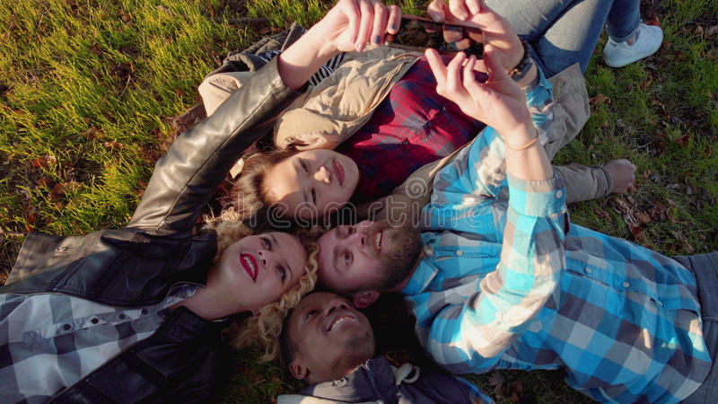 Diverse quartet of friends taking a self portrait stock images