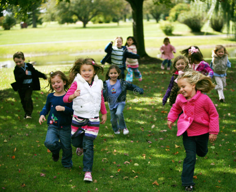 Diverse running kids royalty free stock images