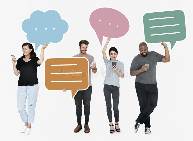 Diverse social media people holding speech bubble symbols royalty free stock photos