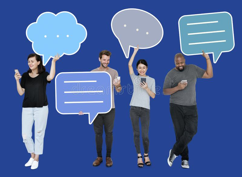 Diverse social media people holding speech bubble symbols royalty free stock images