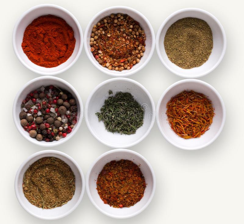 Diverse spices in plates on dark background, closeup, copy space royalty free stock photo