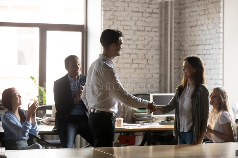 Boss congratulating female employee congratulating with promotion royalty free stock photography