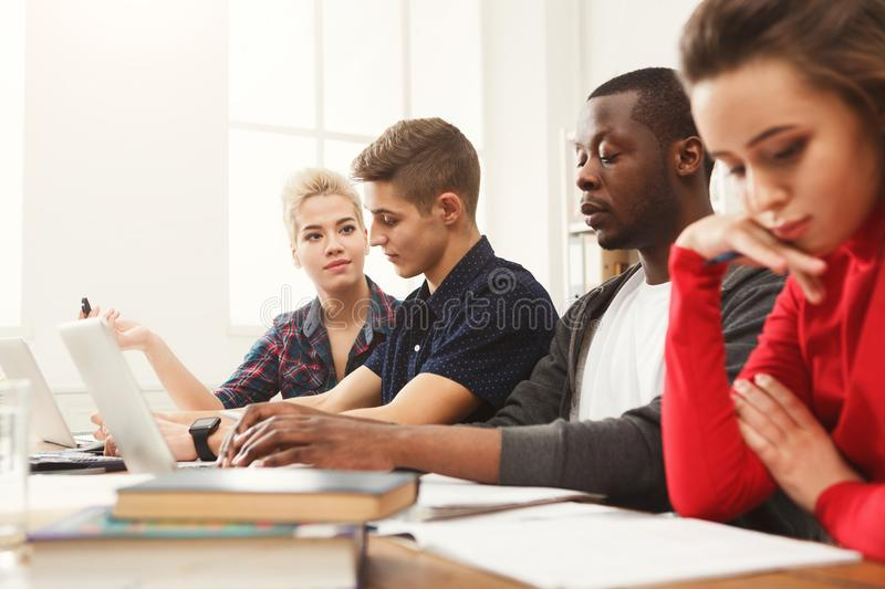 Multiethnic classmates preparing for exams together stock photography