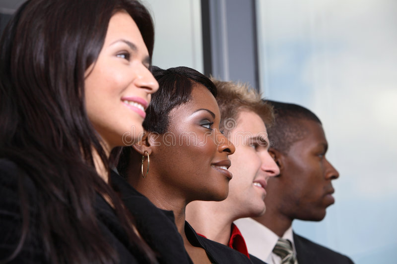 Diverse team from bottom view royalty free stock photography