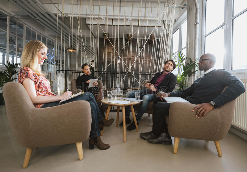 Diverse team of business people meeting in office lobby royalty free stock photo