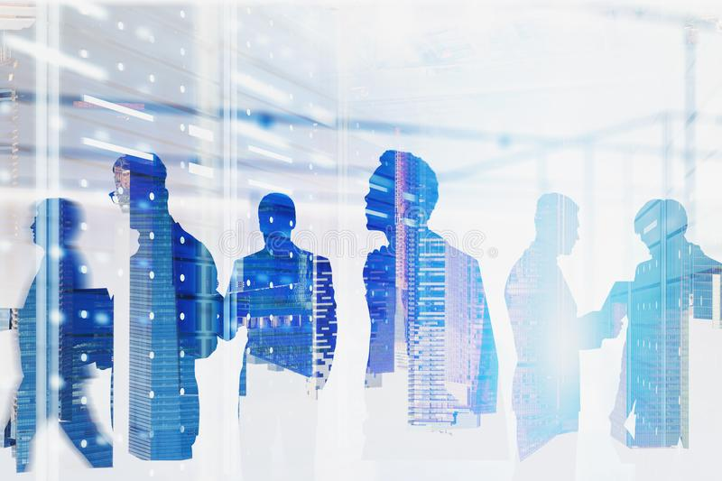 Diverse team of computer engineers in server room royalty free stock images