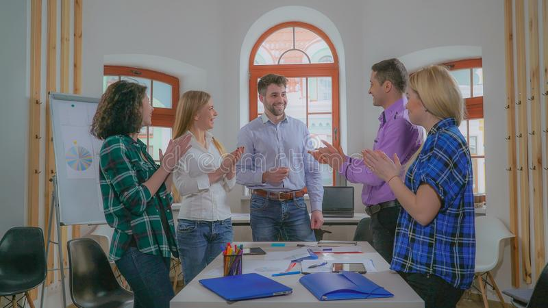 Diverse team discussing project in boardroom. stock photos