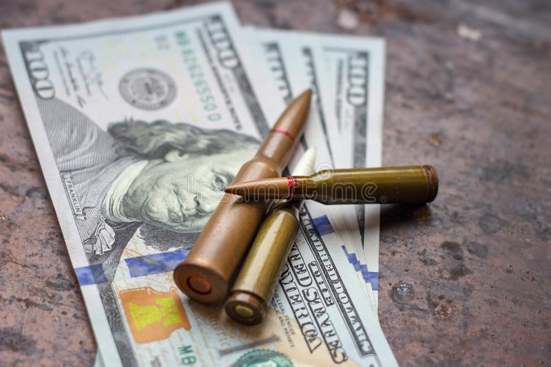 Diverse weapon bullets on American dollars background. Military industry, war, global arms trade and crime concept. Diverse weapon bullets on American dollars stock photos