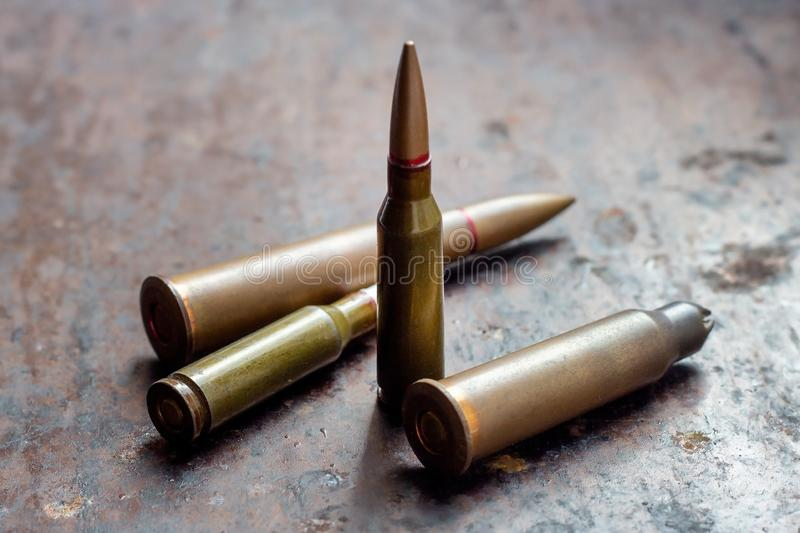 Diverse weapon bullets on rusty metal background. Military industry, war, global arms trade and crime concept.  royalty free stock photo