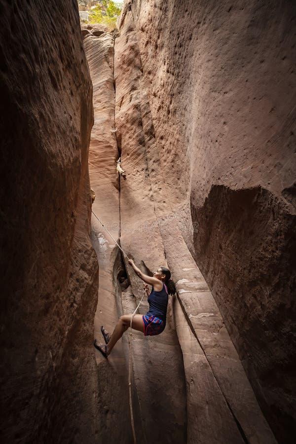 Free Diverse Woman Rock Climbing In A Beautiful Slot Canyon Near Zion National Park Royalty Free Stock Photos - 189567008