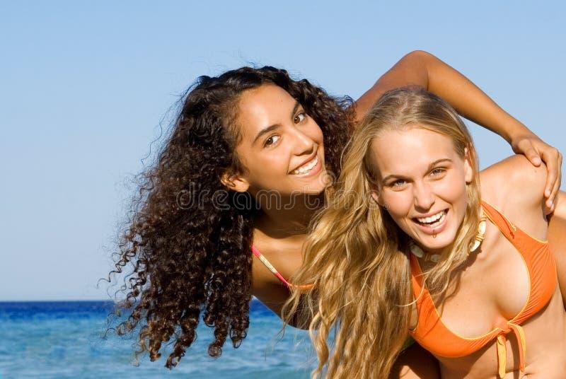 Diverse, women, fun at beach stock photography
