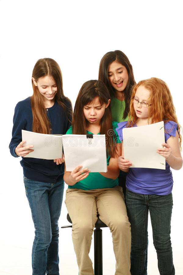 Diverse young girls reading stock images
