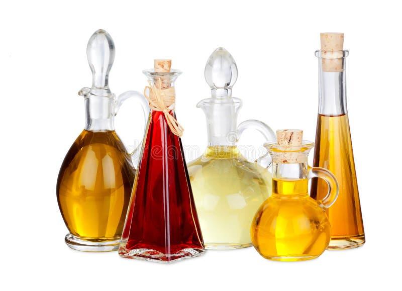 Diverses huiles de friture dans des carafes en verre images libres de droits