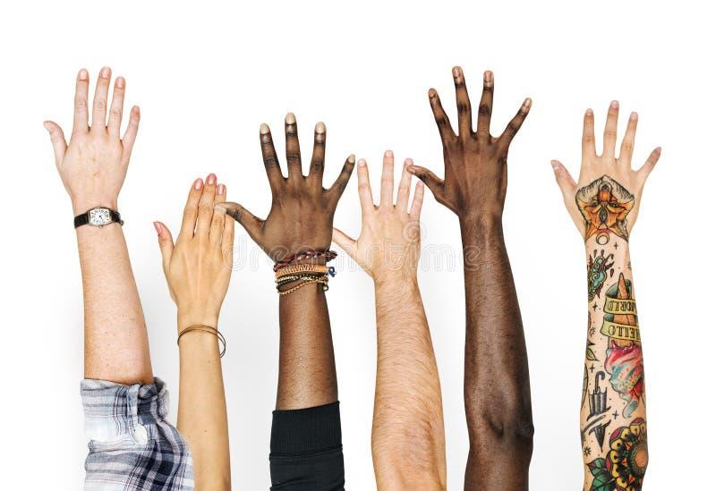 Diversiteitshanden op gebaar worden opgeheven dat royalty-vrije stock afbeelding
