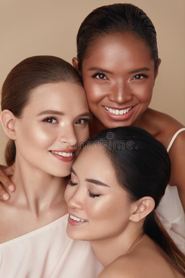 Free Diversity. Beauty Portrait Of Women. Multi-Ethnic Models With Natural Makeup And Perfect Skin Against Beige Background. Royalty Free Stock Images - 187855989