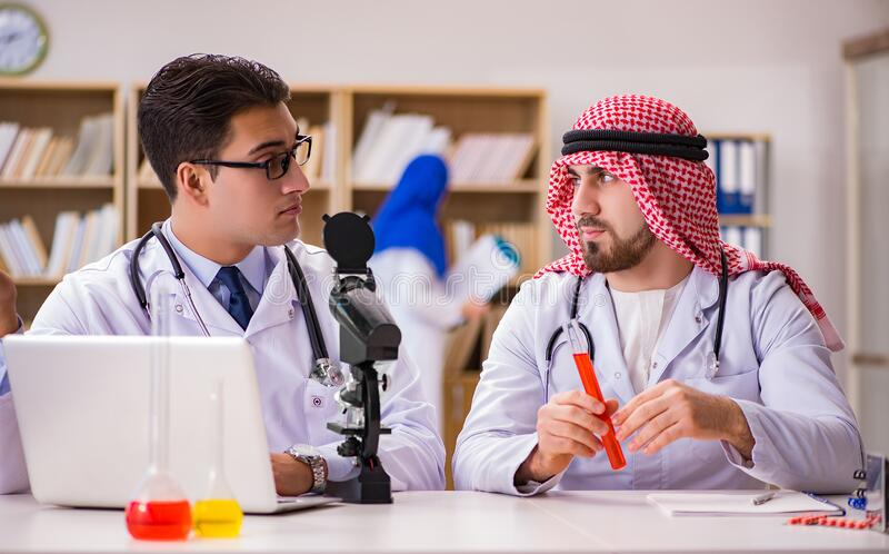 Diversity concept with doctors in hospital royalty free stock photo