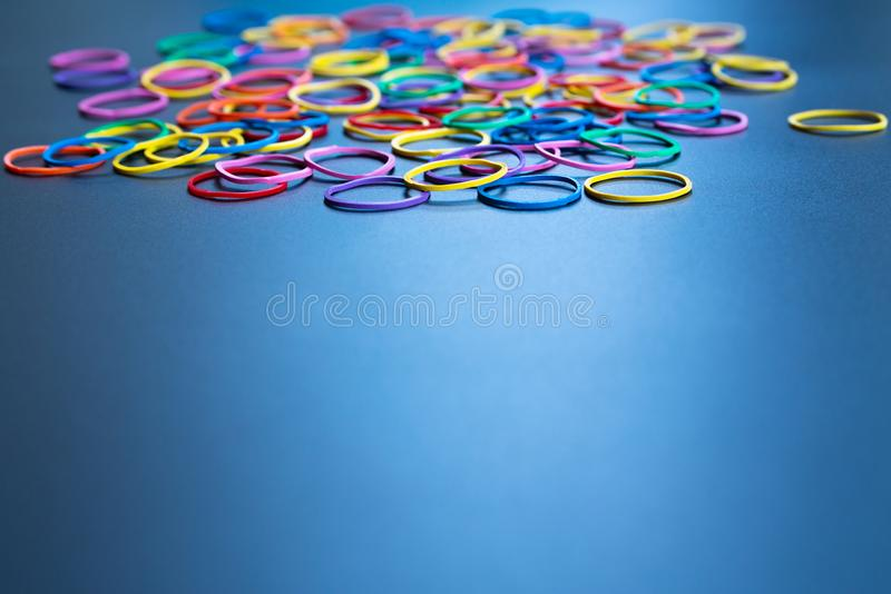 Diversity concept. mix colorful rubber band on black background with copy space stock images