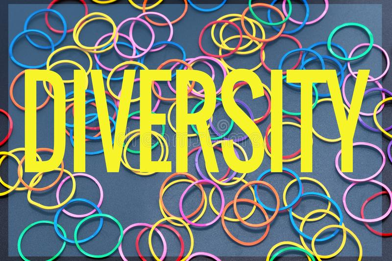Diversity concept. mix colorful rubber band on black background with text Diversity royalty free stock photos