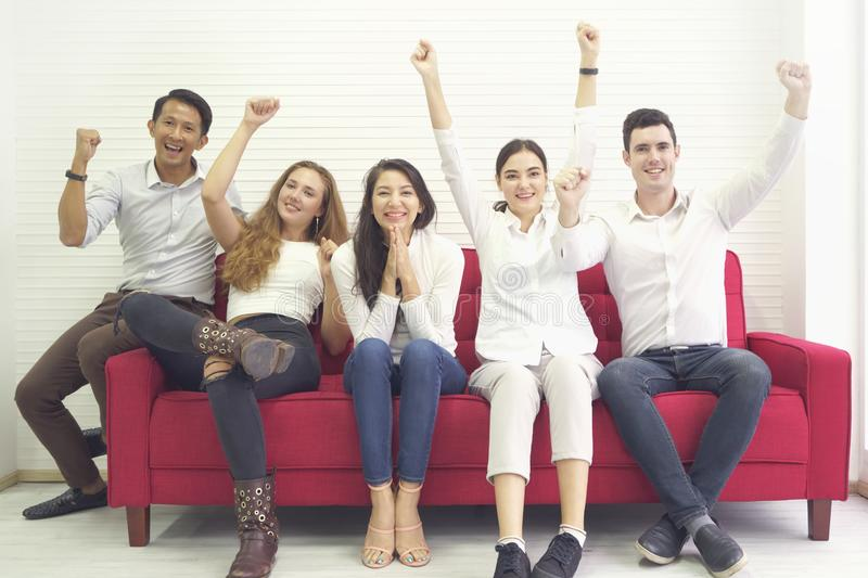Diversity group of people community friends having fun and laughing happy together, sitting on red sofa, cheer game togetherness stock photos