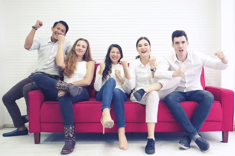 Diversity group of people community friends having fun and laughing happy together, sitting on red sofa, cheer game togetherness stock photography