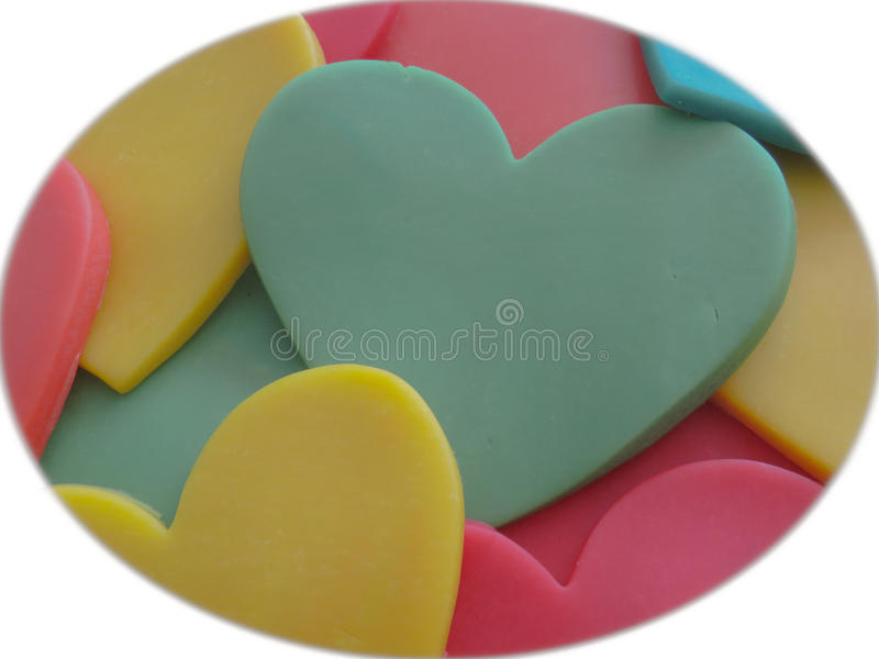 A diversity of hearts. Some hearts in different colors. Craft, childrens play dough stock image