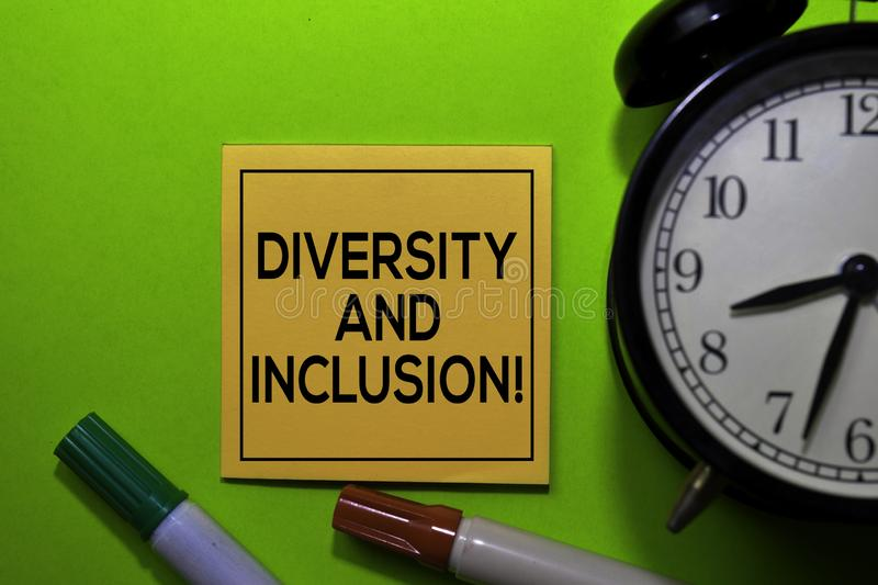 Diversity and Inclusion! write on sticky notes isolated on green background stock images