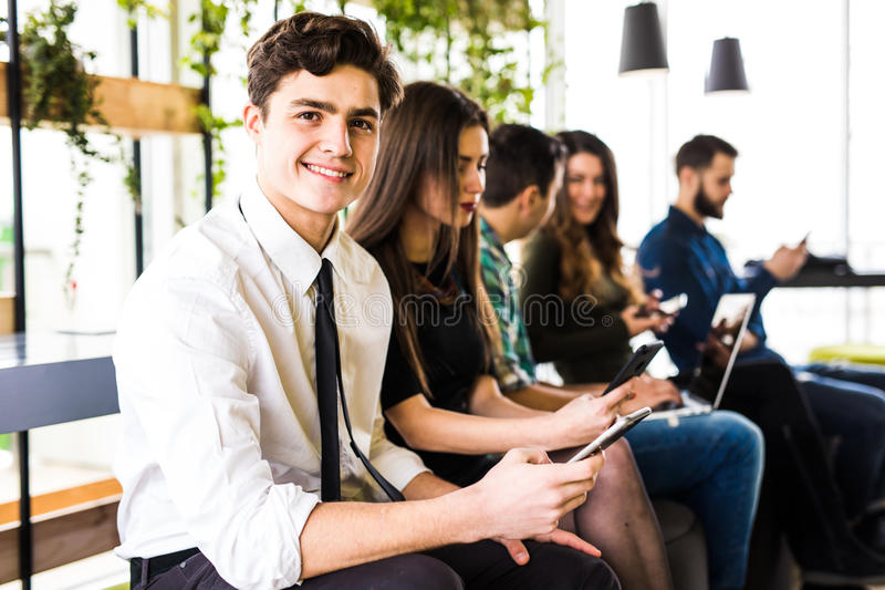 Diversity people connection digital devices browsing concept. Friends. Focus on first man. Diversity People Connection Digital Devices Browsing Concept royalty free stock image