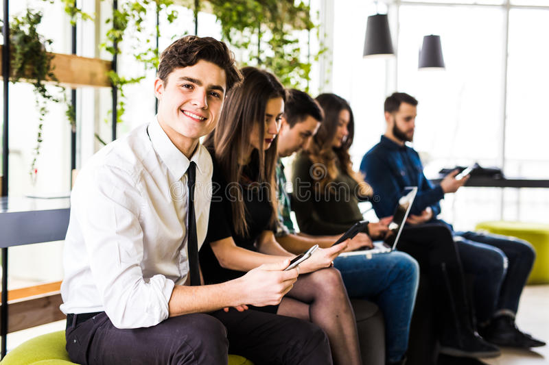 Diversity people connection digital devices browsing concept. Friends. Focus on first man. Diversity People Connection Digital Devices Browsing Concept royalty free stock photo