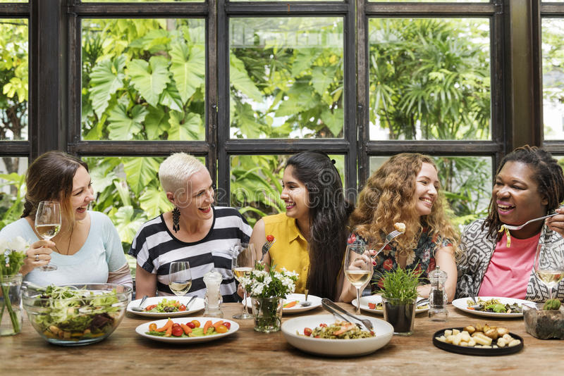 Diversity Women Group Hanging Eating Together Concept.  stock images
