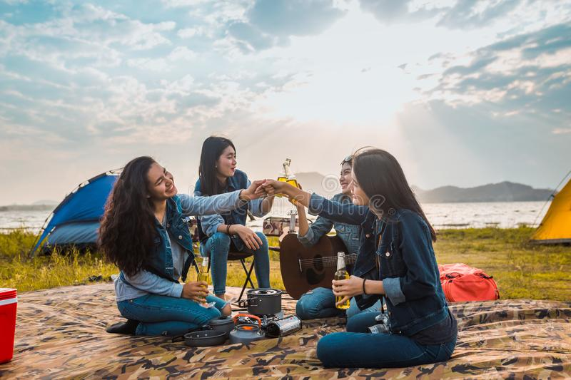 Diversity women party clink bottles enjoy camping. Trekking,travel in vacation time relax stock photos