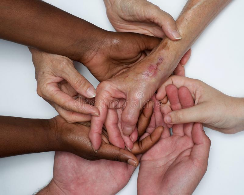 Diversity women`s empowerment hands of color. Working together women of different backgrounds create hand mandalas. diversity wins! created after the women`s stock images