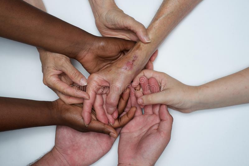 Diversity women`s empowerment hands of color. Working together women of different backgrounds create hand mandalas. diversity wins! created after the women`s royalty free stock photo