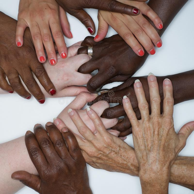 Diversity women`s empowerment hands of color. Working together women of different backgrounds create hand mandalas. diversity wins! created after the women`s royalty free stock photography