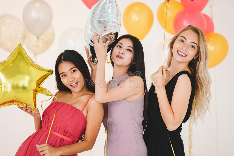 Young women have fun together at party royalty free stock photos