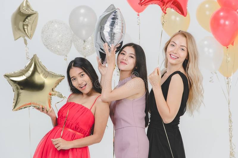 Young women have fun together at party stock photos