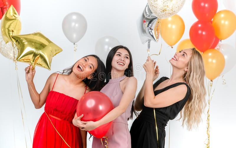 Young women have fun together at party stock photography