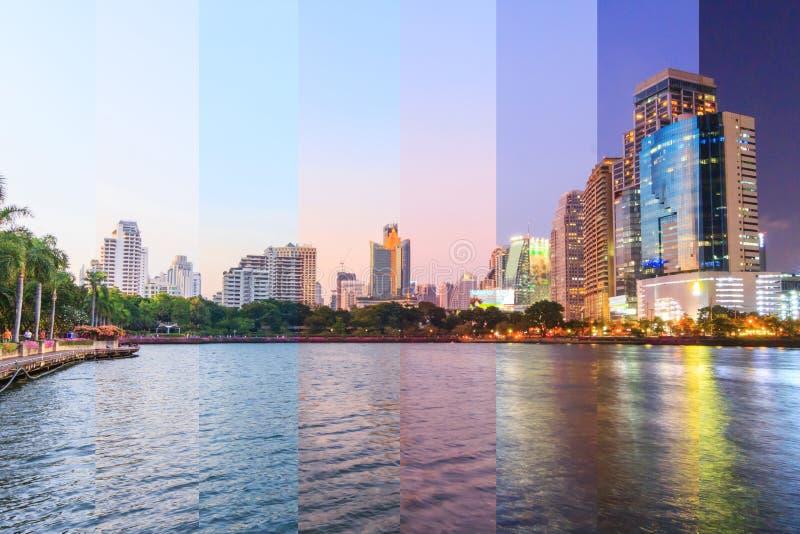Diverso color de la sombra de la opinión del lago con las reflexiones de la ciudad/arriba de la construcción en la opinión del la foto de archivo
