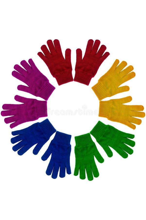 Diverso color hecho punto de los guantes imagenes de archivo