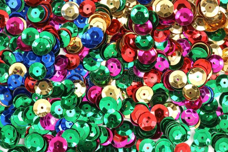 Diversos cequis coloreados para el uso del arte imagenes de archivo