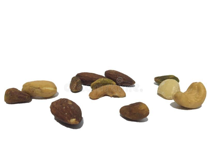 Diversos tipos de nueces, fondo blanco foto de archivo libre de regalías