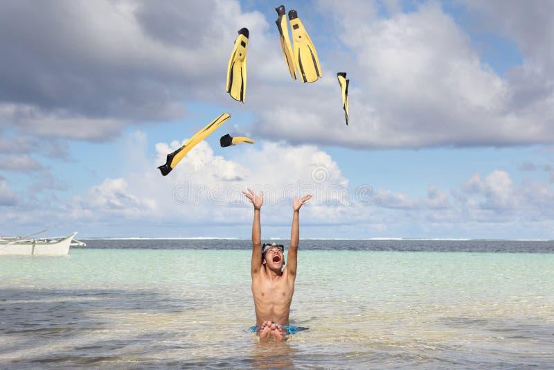 Divertimento della spiaggia con le alette fotografia stock