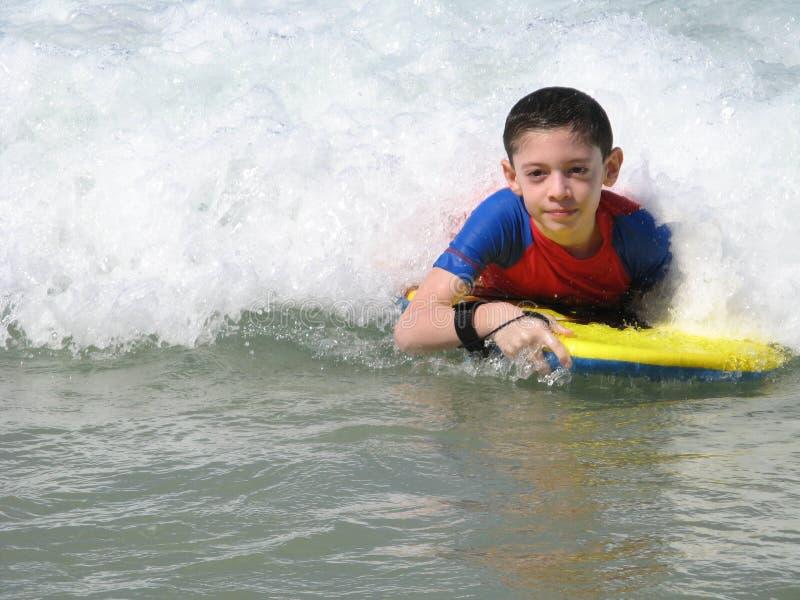 Divertirse en la playa fotografía de archivo