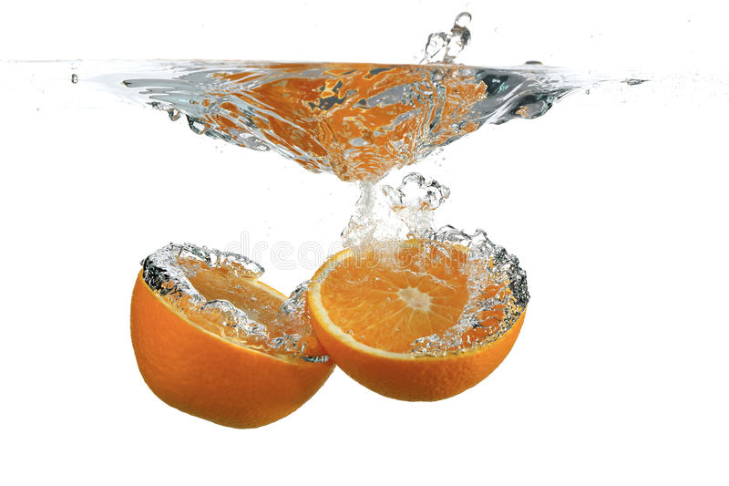 Divided orange in water stock photos