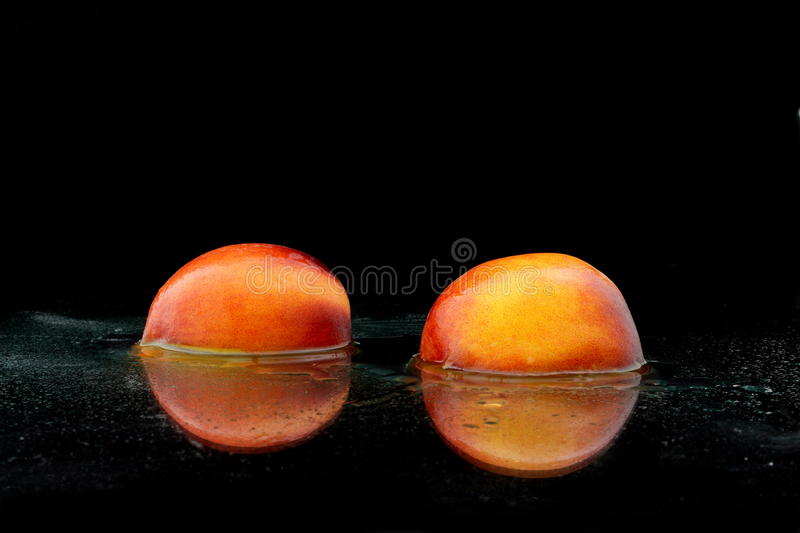 A divided peach royalty free stock photography