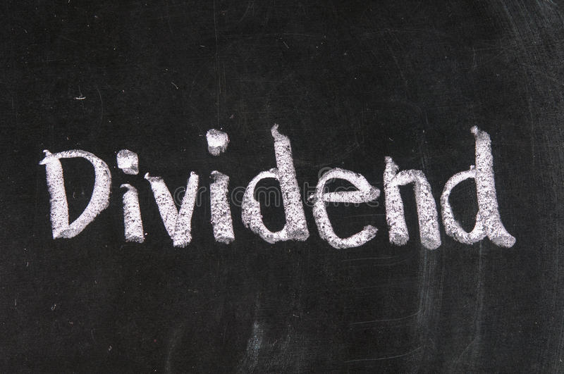 Dividend. Stock Exchange strategy word Dividend made with chalk on a blackboard royalty free stock image