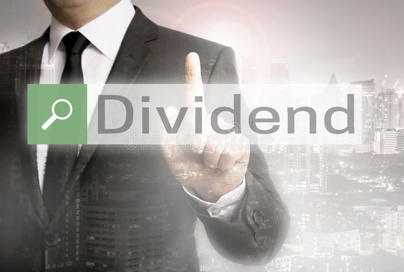 Dividend browser with businessman and city concept.  royalty free stock photography